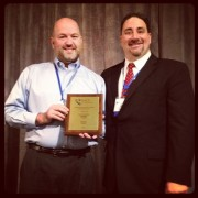 Ray with John Fracchia receiving the  EACE Outstanding Member Award in 2012